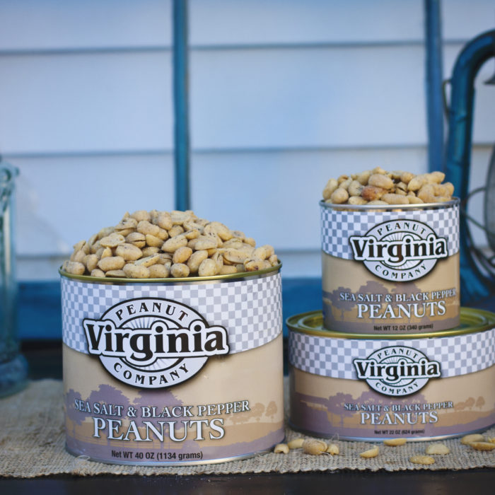 Cans of jumbo sea-salted and black pepper peanuts